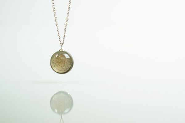 ashes within glass pendant