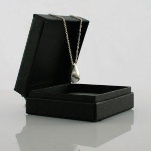 Silver urn charm